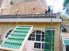 Китаец изобрел солнечный обогреватель воды из пивных бутылок - 20080516134315508_1